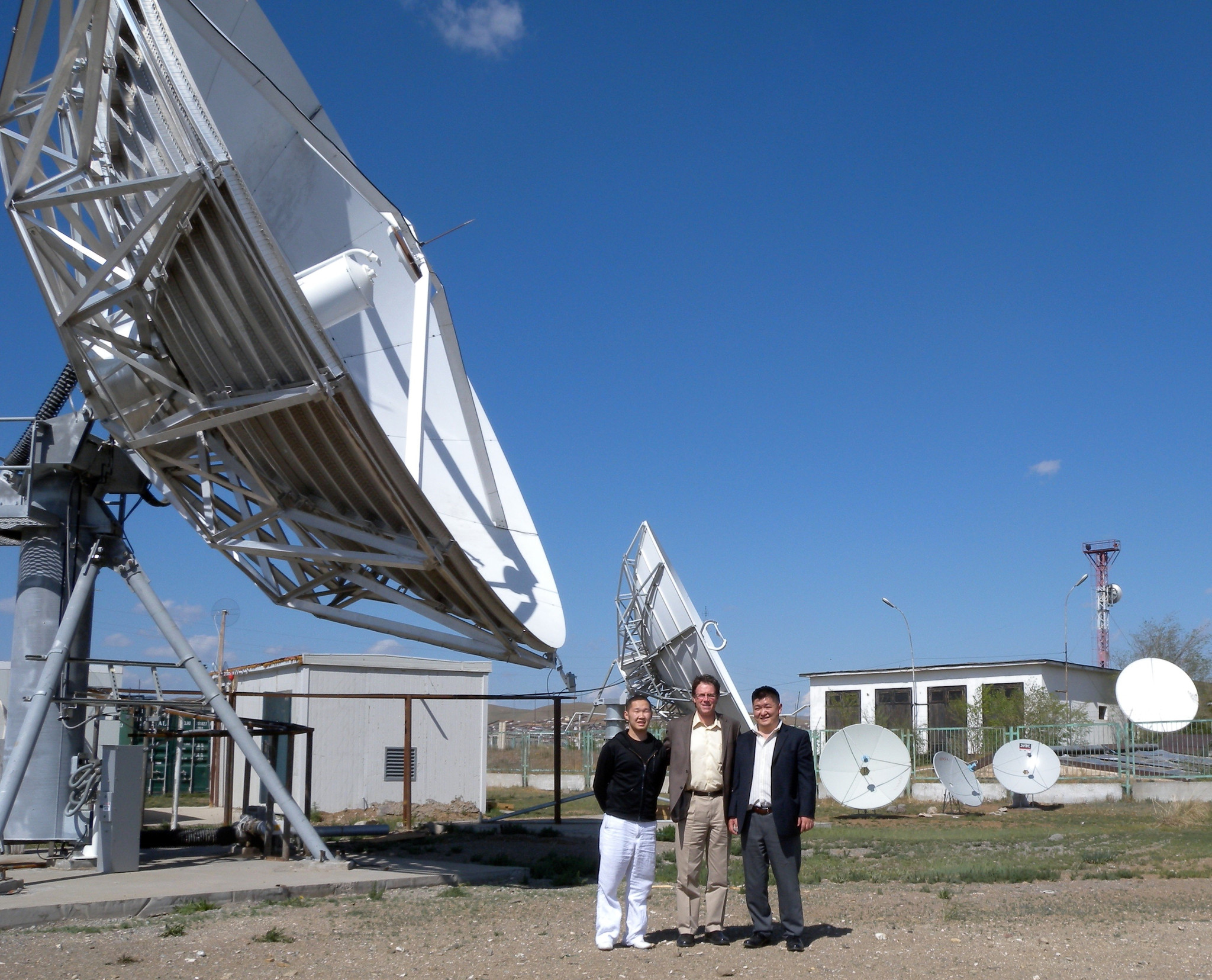 Scott Zimmer (center) visiting a cable/satellite company in Bator, Mongolia, in the early 2000s as head of EchoStar International Corp.